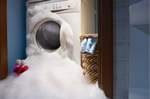 Laundry overflowing with soapy suds
